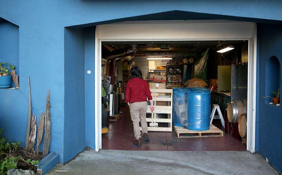 Barbara Gratta of Gratta Wines at her garage winery in the Bayview. Photo: Liz Hafalia, The Chronicle