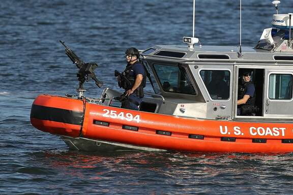 WEST PALM BEACH, FL - FEBRUARY 11:  A U.S. Coast Guard boat patrols the Intracoastal Waterway near Mar-a-Lago Resort where President Donald Trump is hosting Japanese Prime Minister Shinzo Abe on February 11, 2017 in West Palm Beach, Florida. The two are scheduled to get in a game of golf as well as discuss trade issues.  (Photo by Joe Raedle/Getty Images)
