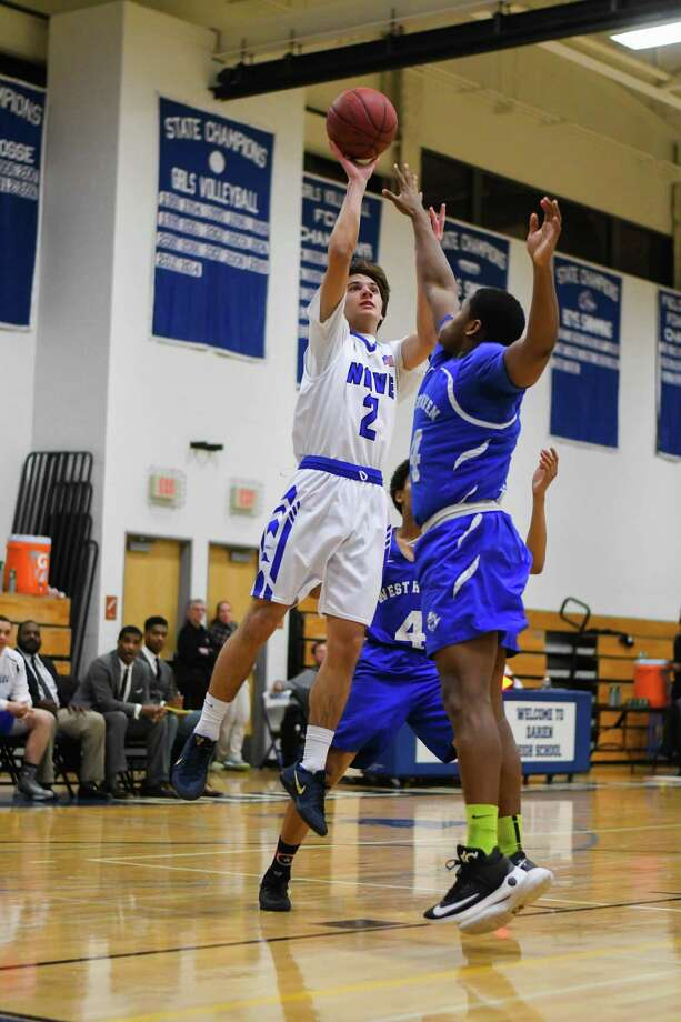 Darien's William Rolapp shoots against West Haven on Monday at Darien High School. Photo: Gregory Vasil / For Hearst Connecticut Media / Connecticut Post Freelance