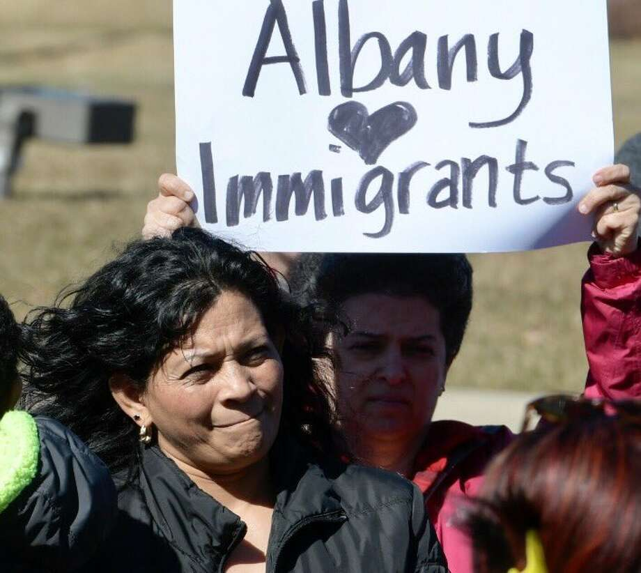 Elsa Martinez is surrounded by family and friends as she reports to the U.S. Immigration and Customs Enforcement office in Colonie on Wednesday. (Skip Dicktein / Times Union)
