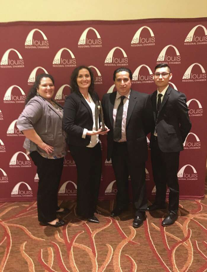 From left, TheBANK of Edwardsville's Marisa Buffa, Sandy Smith, Eric Herrera and Jorge Medina pose with the Arcus Award Thursday. TheBANK won the award in the Achievement Inclusion and Talent Attraction category for its Fairmont City Center, the first fully bilingual, full service banking center in the St. Louis area. Photo: For The Intelligencer
