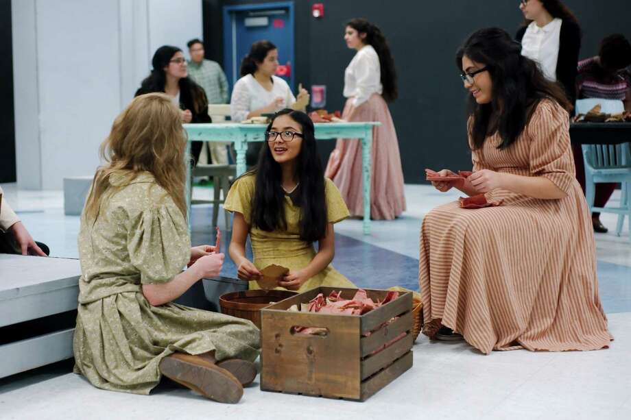 "In Pasadena High School's  ""Anna in the Tropics,""   Caitlin Conklin, left, Viviana Perez and Maritza Valle portray Cuban workers who are entertained by a man reading from Tolstoy's ""Anna Karenina"" as they roll cigars. The play is the school's entry in University Interscholastic League one-act play competition and will be performed at 4 p.m. March 32 at Dobie High School. Photo: Kirk Sides / © 2017 Kirk Sides / Houston Chronicle"