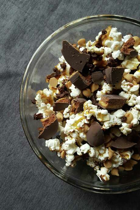 Tagalong popcorn mix combines popcorn, peanut butter chips, chocolate chips, and Girl Scout cookies to make a sweet and savory treat. (Credit: Deanna Fox)