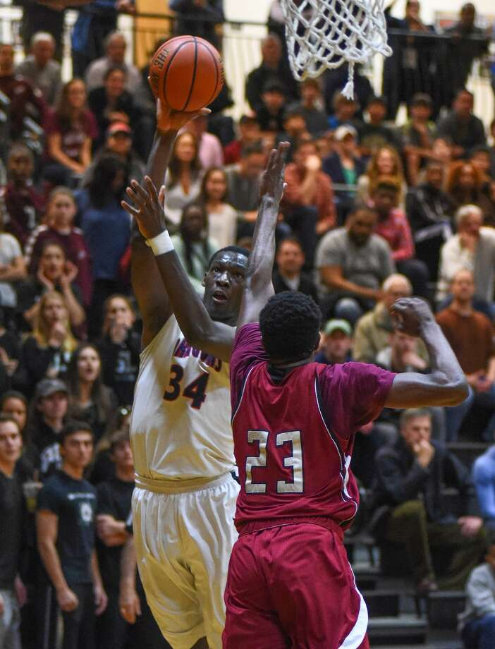 Greens Farms Academy senior Sunday Okeke of Darien had 23 points in the New England Tournament final game against St. Luke's. Okeke had a tournament total of 64 points. Photo: Contributed Photo / Darien News contributed