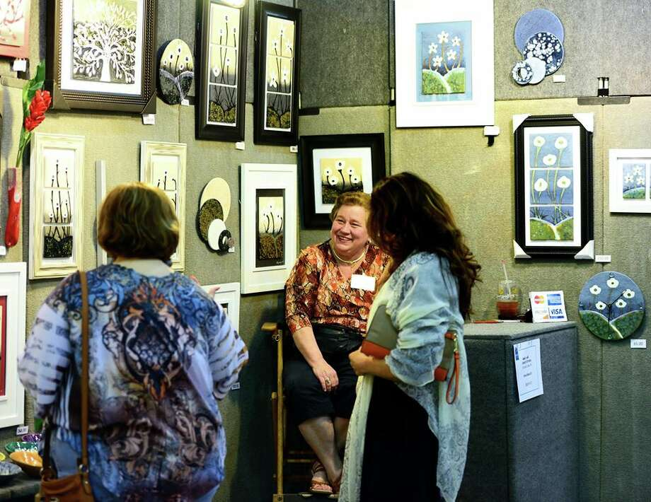 Visitors stop at a booth at a past Art Fair at Queeny Park. Photo: For The Edge