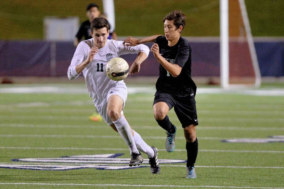 Jairo andres Cano (11) of Stratford and Emmanuel Fernandez(17) of Spring Woods compete to gain control of a ball during the second half of a boys high school soccer game between the Stratford Spartans and the Spring Woods Tigers on Tuesday, March 7, 2017 at Tulley Stadium, Houston, TX. Photo: Craig Moseley, Staff / ©2017 Houston Chronicle
