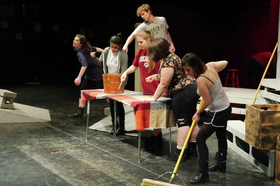 """Clear Lake High School theater students  rehearse a scene from """"Scenes from The Gut Girls"""" in which women in an early 20th century """"gutting shed"""" in England ponder their lives as they work with cattle carcases amid pools of blood. Altough the cast must contend with sticky fake blood, """"they are loving it,"""" director Colette Currie says. Photo: Kirk Sides / Houston Chronicle / © 2017 Kirk Sides / Houston Chronicle"""