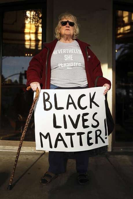 Margaret Hasselman during weekly protest by grassroots organization Indivisible. Photo: Scott Strazzante, The Chronicle