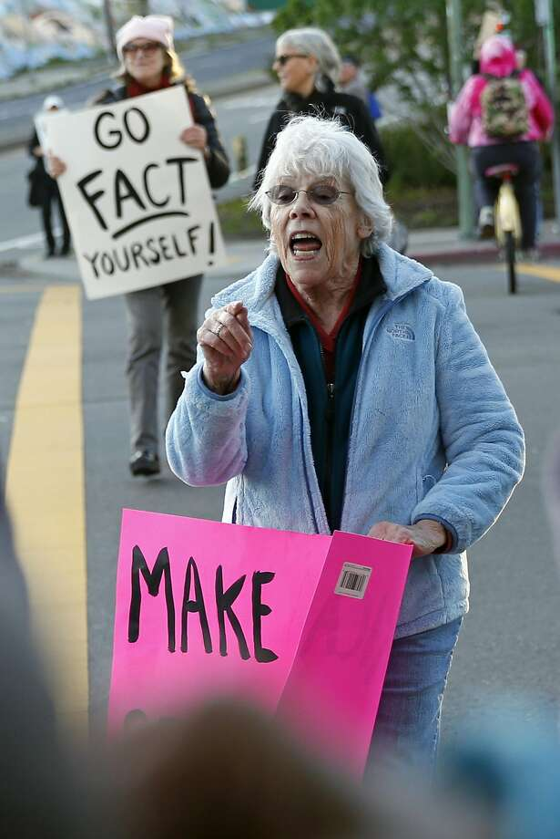 Jane Vinson joins a protest by members of an Indivisible group on Grand Avenue in Oakland last week. Photo: Scott Strazzante, The Chronicle