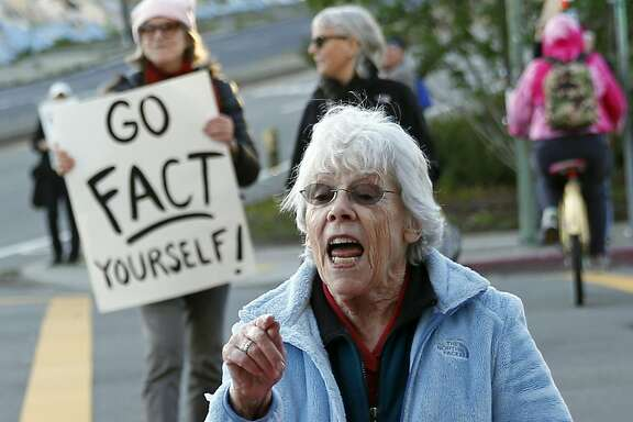 Jane Vinson of Rossmoor during weekly protest by grassroots organization Indivisible on Grand Avenue in Oakland, Calif., on Tuesday, March 7, 2017.