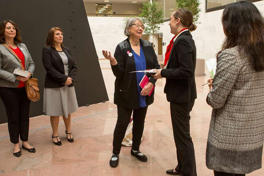 Kathy Kneer (center), head of Planned Parenthood of California, meets with Elizabeth Fox, legislative aide to Sen. Dianne Feinstein, in Washington, D.C. Photo: Allison Shelley, Special To The Chronicle