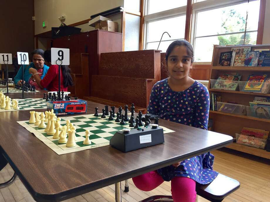 Sanya Badhe, 10, of San Jose was all smiles as she prepared for her third match of the All Girls, Age-Level State Chess Championship Tournament on Saturday, March 4. Photo: Beth Spotswood