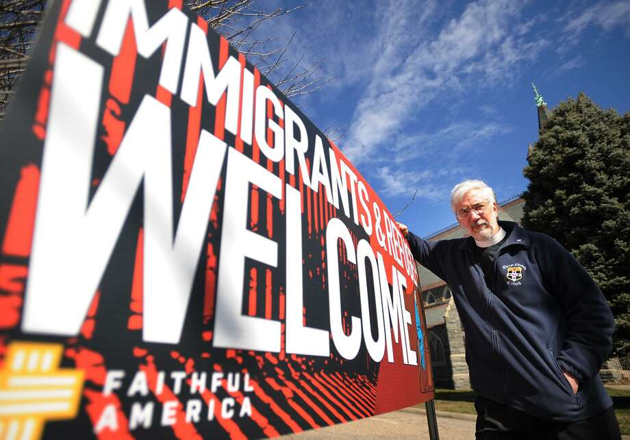 """Rev. Geoffrey Hahneman with the """"Immigrants & Refugees Welcome"""" sign outside St. John's Episcopal Church in Bridgeport, Conn. on Wednesday, March 8, 2017. Photo: Brian A. Pounds / Hearst Connecticut Media / Connecticut Post"""