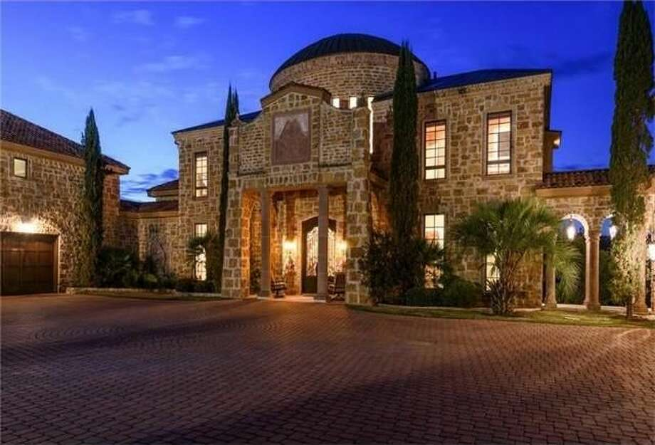 Celebrity couple David Draiman of the rock bands Disturbed and Device, and wife Lena Yada of WWE Diva fame, are selling their castle-like home in Austin, Texas. Photo: Realtor.com