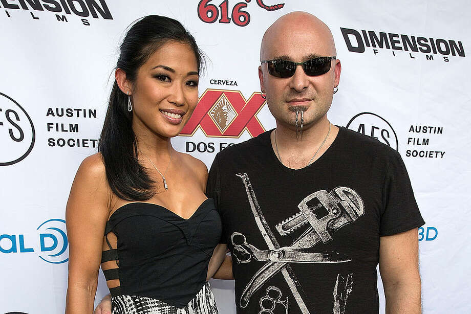 Vocalist David Draiman (R) and his wife actress/model Lena Yada arrive at the premiere of 'Sin City: A Dame to Kill For' at the Paramount Theatre on August 20, 2014 in Austin, Texas.  (Photo by Rick Kern/WireImage) Photo: Rick Kern/WireImage