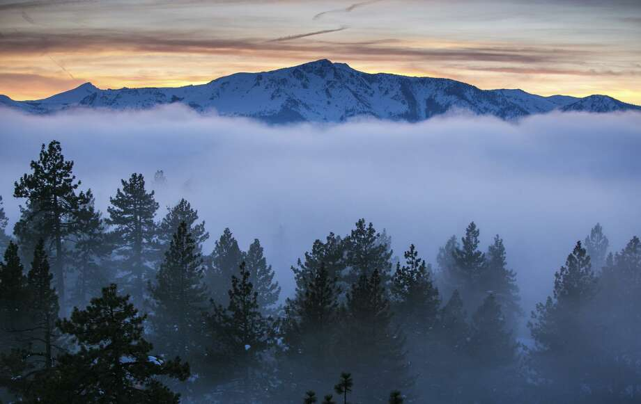 A bank of fog hangs over South Lake Tahoe in January. Nearby ski areas report 600 to 700 inches of snow this season. Photo: George Rose / Photos By George Rose / Getty Images / 2017 George Rose