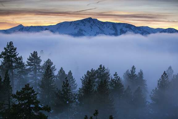 A bank of fog hangs over South Lake Tahoe in January. Nearby ski areas report 600 to 700 inches of snow this season.