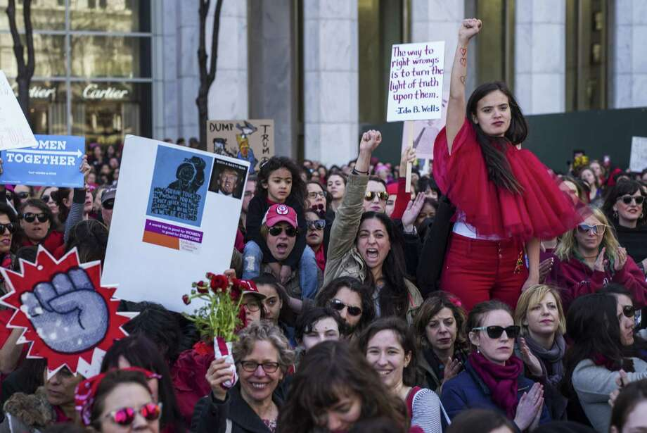Demonstrators gather at the corner of 59th Street and Fifth Avenue in New York as part of the A Day Without a Woman protest Wednesday. Photo: Todd Heisler /New York Times / NYTNS