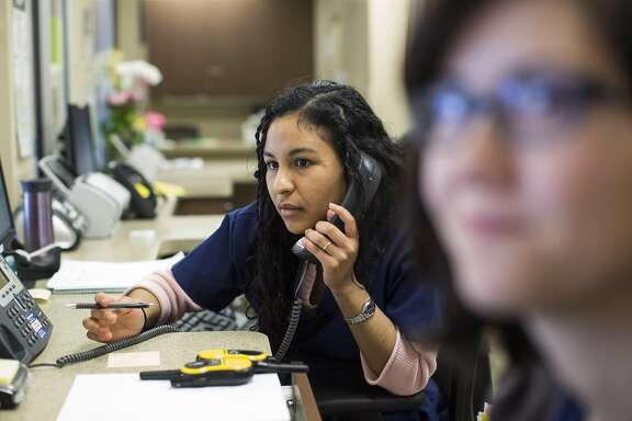 Health services specialists Lisette Hamilton (left) and Lica Sato-Keane work on rescheduling patient appointments at Planned Parenthood Redwood City Health Center in Redwood City, Calif., on Wednesday, March 8, 2017. The new GOP plan to replace the Affordable Care Act aims to end federal funding to Planned Parenthood. California clinics, which get more than half the federal funding that Planned Parenthood receives each year from federal Medicaid dollars, would be greatly impacted.
