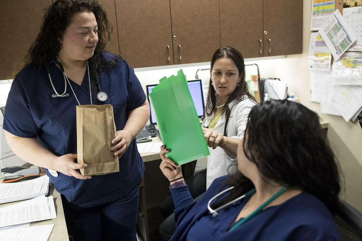 Physician Margaux Lazarin (center) talks about a patent's treatment with primary care coordinator Yetzenia Licea (right) and health service specialist Karina Robles (left) at Planned Parenthood Redwood City Health Center in Redwood City, Calif., on Wednesday, March 8, 2017. The new GOP plan to replace the Affordable Care Act aims to end federal funding to Planned Parenthood. California clinics, which get more than half the federal funding that Planned Parenthood receives each year from federal Medicaid dollars, would be greatly impacted.