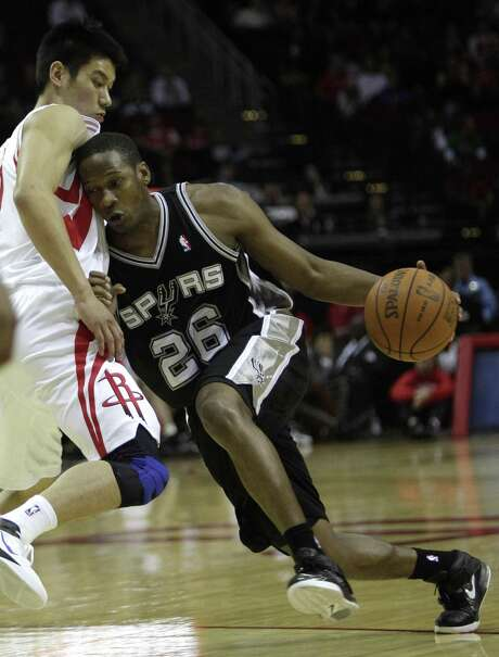 Spurs guard Antoine Hood drives with the ball against the Rockets guard Jeremy Lin during the second half of a preseason game at the Toyota Center on Dec. 17, 2011, in Houston. Photo: Brett Coomer /Houston Chronicle / © 2011 Houston Chronicle