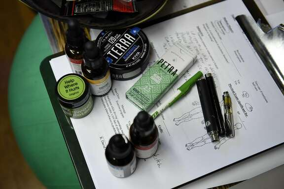 A selection of medical cannabis tinctures, topical creams, edibles, and vaporizer pens are seen in the office of nurse practitioner Eloise Theisen during a meeting with new patients, in Lafayette, CA, on Wednesday March 8, 2017,