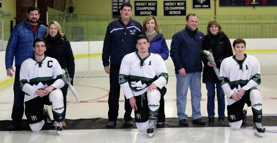 The New Milford High School boys' ice hockey team recently wrapped up its final regular game of the season, winning the game against East Catholic in over time. The score of the Feb. 22 game was 3-2. The game was also senior night. Above, players are shown with their parents from left to right: Payton Meyer with his parents, Heather and John; Christian Schopfer with his parents, Larry and Bernadette; and Thomas Schneider with his parents, Mike and Cindy. Photo: Courtesy Of Katie Alzapiedi / The News-Times Contributed