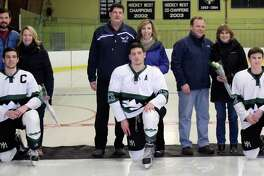 The New Milford High School boys' ice hockey team recently wrapped up its final regular game of the season, winning the game against East Catholic in over time. The score of the Feb. 22 game was 3-2. The game was also senior night. Above, players are shown with their parents from left to right: Payton Meyer with his parents, Heather and John; Christian Schopfer with his parents, Larry and Bernadette; and Thomas Schneider with his parents, Mike and Cindy.