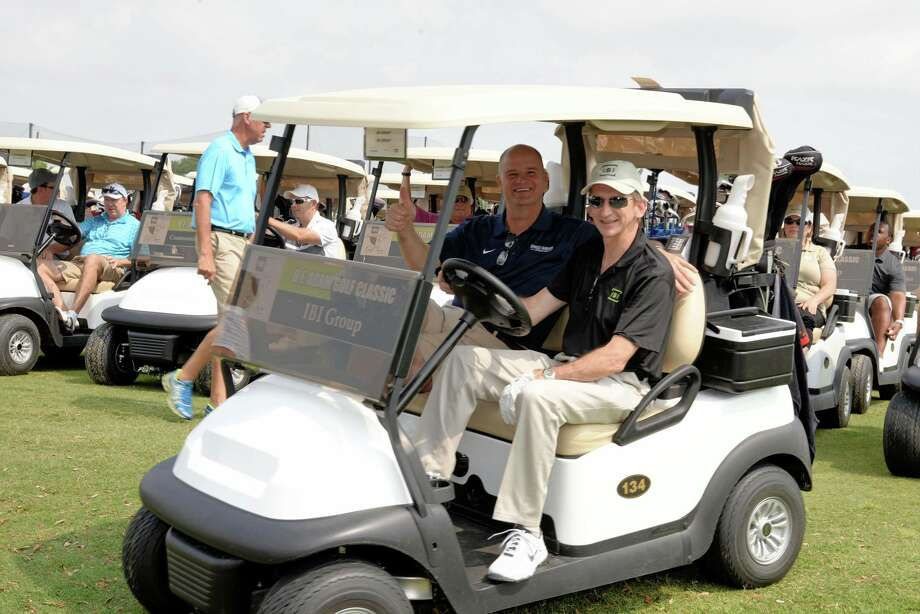 Superintendent Mark Henry, left, and Mark French, IBI - Platinum Sponsor heading out onto the course at the 2016 B. F. Adam Golf Classic. The Cy-Fair Educational Foundation's 29th Annual B.F. Adam      Classic is set for May 11 at the Black Horse Golf Club. Through the      nearly three decades of its existence, the tournament has raised more than      $2.7 million in student scholarships for Cy-Fair Independent School      District graduates. Photo: CFISD
