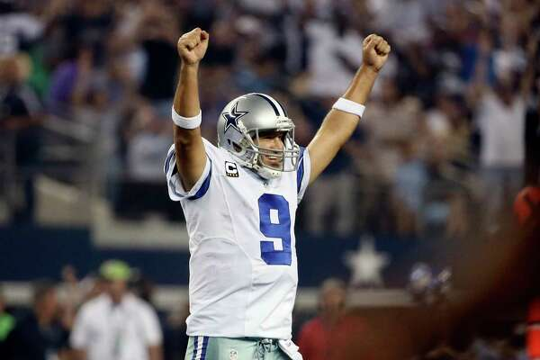 FILE - In this Sept. 28, 2014, file photo, Dallas Cowboys' Tony Romo celebrates a touchdown run by DeMarco Murray during the second half of an NFL football game against the New Orleans Saints,  in Arlington, Texas. A person with knowledge of the decision tells The Associated Press that the Dallas Cowboys will release quarterback Tony Romo when the NFL year opens on Thursday. The person spoke to The Associated Press on Wednesday, March 8, 2017,  on condition of anonymity because the team hasn't announced a decision on Romo, who will get a chance to pursue a starting job elsewhere.(AP Photo/Brandon Wade, File)