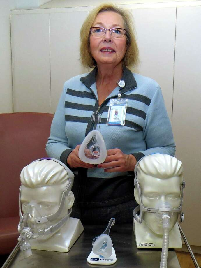 Bridgeport Hospital Center for Sleep Medicine Clinical Coordinator Liz Iaboni displays various CPAP masks, which are available in a variety of sizes and styles to guarantee the best fit and most comfort for each patient. Photo courtesy of Bridgeport Hospital. Photo: Contributed / Contributed