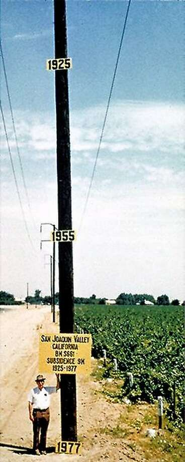 The sinking of the San Joaquin Valley is not new, as this 1977 USGS photo shows. But NASA data show it accelerated in 2015-2016 during the drought, with some areas seeing subsidences of nearly two feet.
