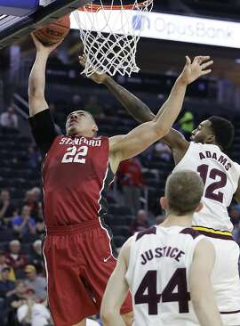 Stanford's Reid Travis (22) shoots over Arizona State's Andre Adams during the first half of an NCAA college basketball game in the first round of the Pac-12 men's tournament Wednesday, March 8, 2017, in Las Vegas. (AP Photo/John Locher)