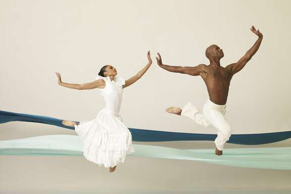 "Linda Celeste Sims and Glenn Allen Sims of the Alvin Ailey American Dance Theater perform in Ailey's classic ""Revelations"" at Berkeley's Zellerbach Hall through Sunday, March 19.  Photo by Andrew Eccles"