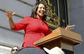 Board president London Breed rallies in front of city hall during International Women's Day on Wednesday, March 8, 2017, in San Francisco, Calif.