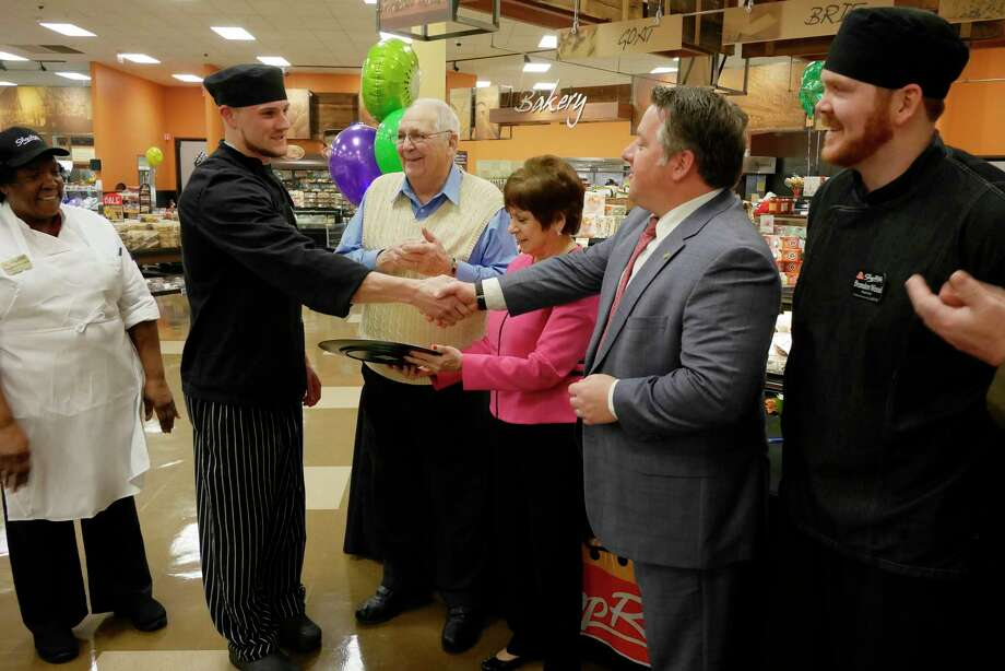ShopRite chefs, Paulette Dussard, left, Nick Mancinelli, second from left, and Brandon Wood, far right, take part in the third annual Golden Fork Award Challenge at ShopRite on Central Ave. on Wednesday, March 8, 2017, in Colonie, N.Y.  The judges were, Village of Colonie Mayor Frank Leak, third from left, Colonie Town Supervisor Paula Mahan, fourth from left, and Albany County Executive Daniel McCoy.  Mancinelli placed first with his sprout salad.  Three ShopRite chefs took part in the contest, using ingredients available at ShopRite stores.  The chefs worked with a ShopRite dietitian to prepare food that is healthy and delicious.      (Paul Buckowski / Times Union) Photo: PAUL BUCKOWSKI / 20039890A