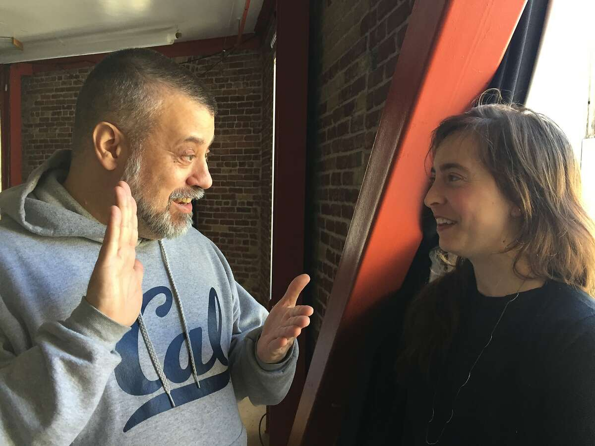SAFEhouse for the Arts founder Joe Landini shares a laugh with Lili Weckler, a Lead Artist in his Resident Artist Workshop, at 1 Grove St. SAFEhouse will soon move to a long-term home at 145 Eddy St. Photo by Claudia Bauer