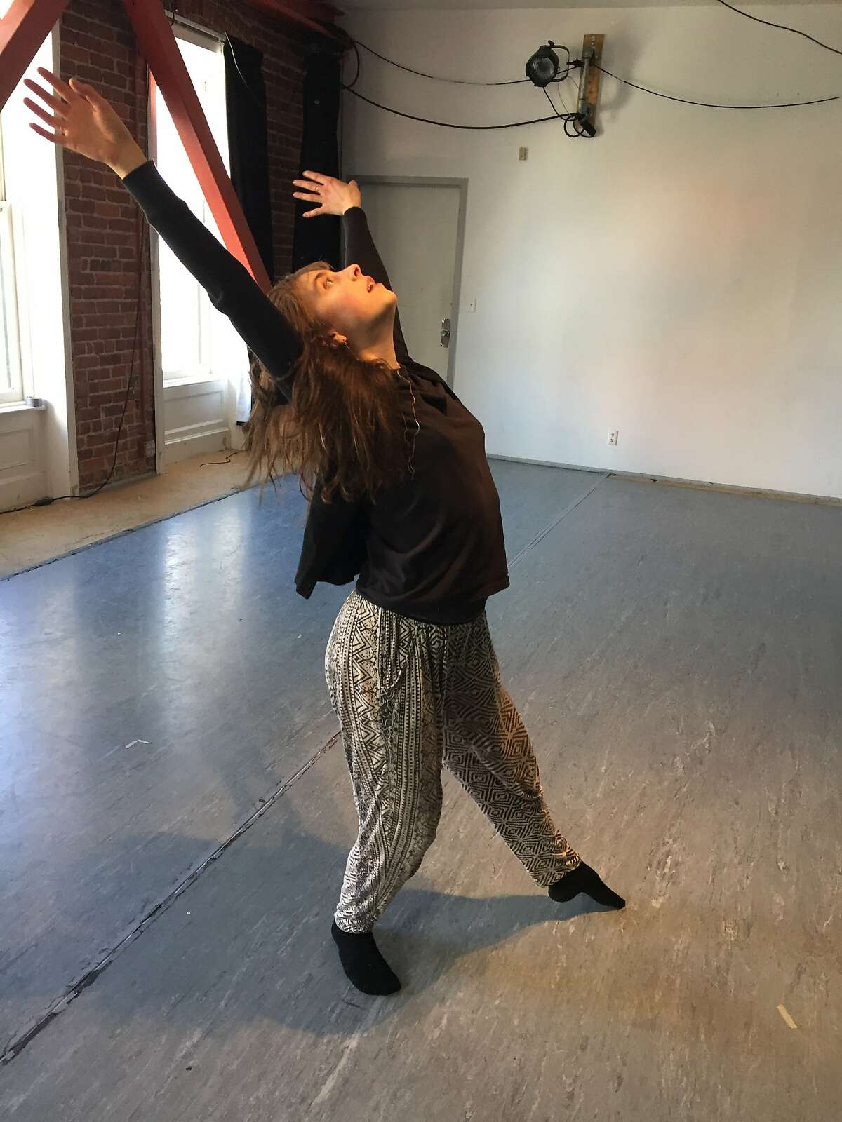 SAFEhouse resident artists Lili Weckler rehearses in the nonprofit�s current space at 1 Grove St. SAFEhouse is evolving into a collective and just landed a long-term lease at 145 Eddy St. Photo by Claudia Bauer