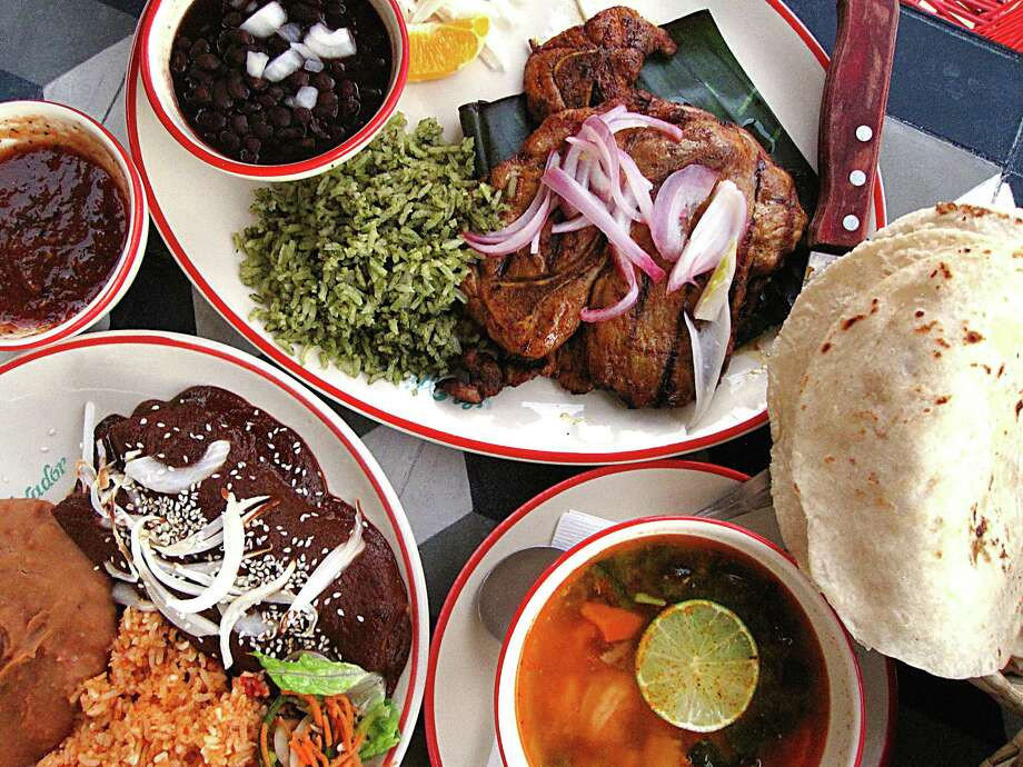 Food from El Mirador restaurant on South St. Mary's Street. Clockwise from top: Puerco yucateco, handmade tortillas, seafood soup and chicken mole enchiladas. Photo: Mike Sutter /San Antonio Express-News