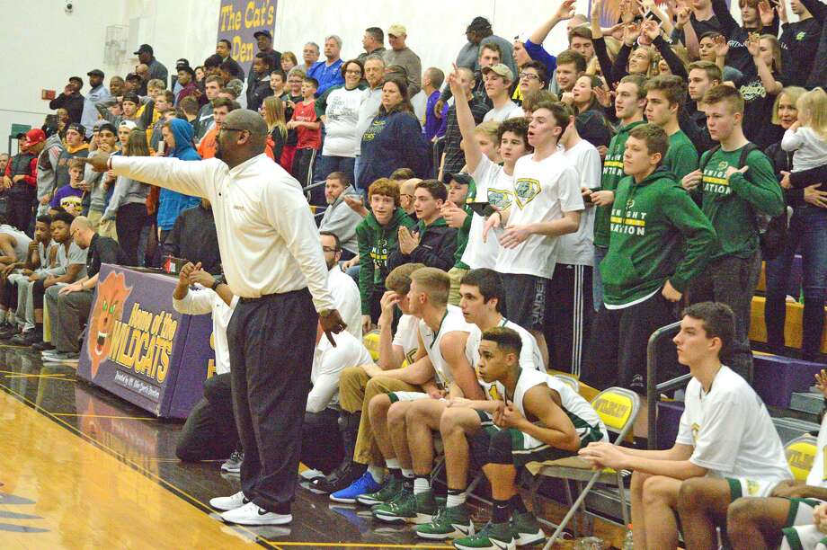 Metro-East Lutheran coach Anthony Smith shouts out instruction late in a regional championship game against Madison in Mount Olive.
