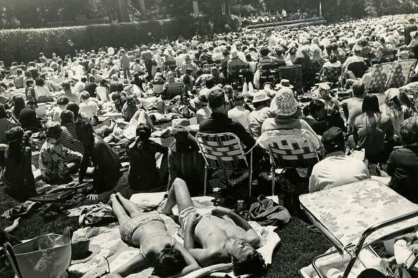 Mr. and Mrs. Dennis Watson sunbathe at Stern Grove in San Francisco on July 5, 1971.