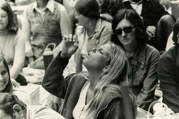 One girl blew soap bubbles during a concert at Stern Grove in San Francisco on July 29, 1974.