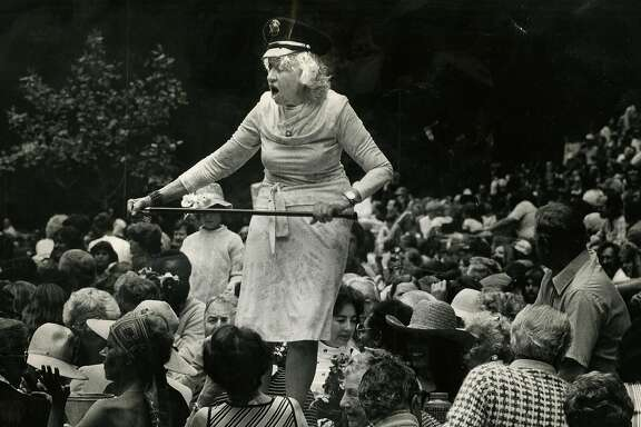 Gladys Sargent dances on a picnic table during the Preservation Hill Jazz band concert in Stern Grove in San Francisco on July 11, 1980.