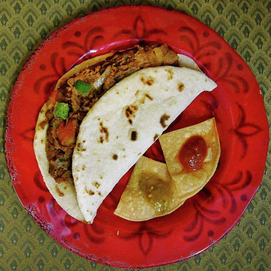 Chorizo and bean a la mexicana taco on a handmade flour tortilla from Bella's Mexican Restaurant on East Houston Street. Photo: Mike Sutter /San Antonio Express-News