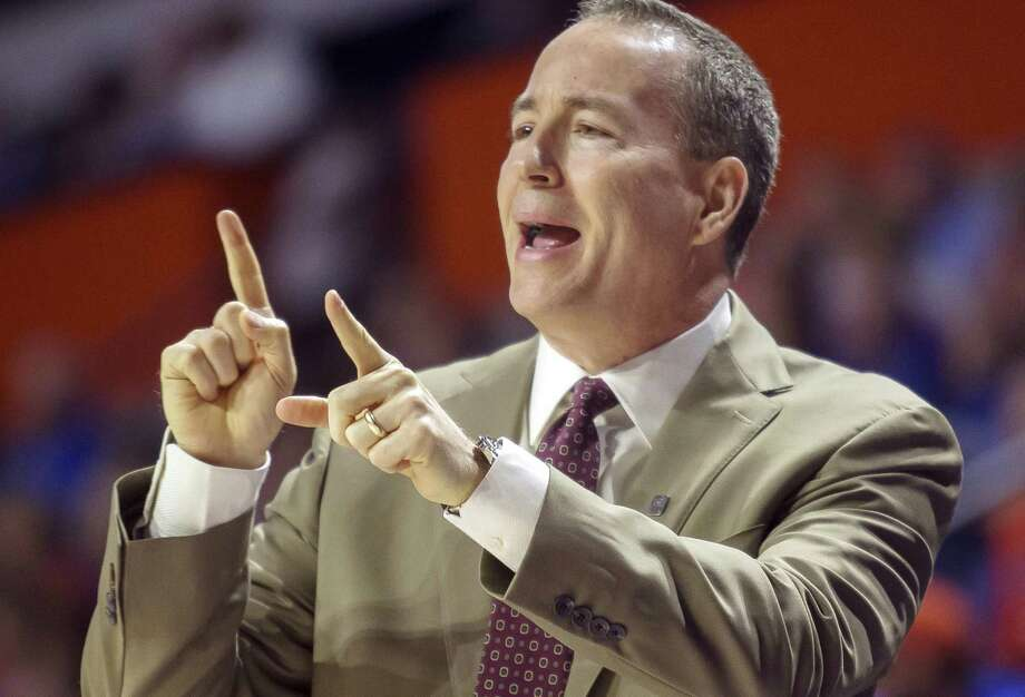Texas A&M coach Billy Kennedy signals instructions to his team during the first half against Florida in Gainesville on Feb. 11, 2017. Photo: Ron Irby /Associated Press / FR171372 AP