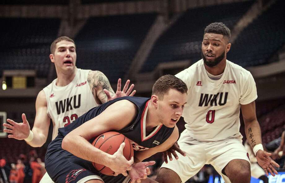 UTSA center Lucas O'Brien (15) calls a timeout as he is trapped by Western Kentucky forwards Justin Johnson (23) and Jabari McGhee (0) during the Conference USA tournament, Wednesday, March 8, 2017, at Legacy Arena in Birmingham, Ala. Photo: Austin Anthony /Associated Press / Daily News