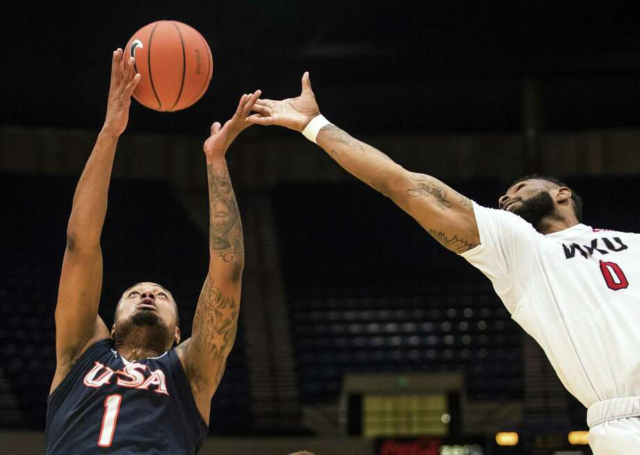 UTSA forward Jeff Beverly (1) grabs a rebound ahead of Western Kentucky forward Jabari McGhee (0) in the Conference USA tournament, Wednesday, March 8, 2017, at Legacy Arena in Birmingham, Ala. Photo: Austin Anthony /Associated Press / Daily News