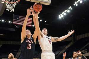 Western Kentucky forward Justin Johnson (23) and UTSA center Lucas O'Brien (15) battle for a rebound during the Conference USA tournament, Wednesday, March 8, 2017, at Legacy Arena in Birmingham, Ala.