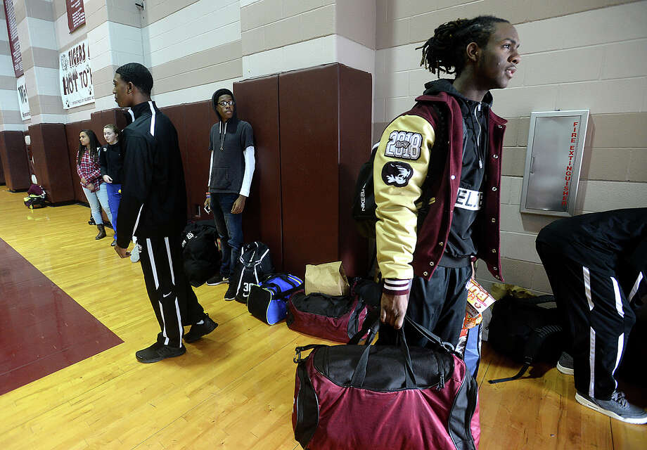 Silsbee's varsity get ready to board their bus Wednesday morning. The team is San Antonio bound for its second consecutive run at the state tournament trophy. Semifinals will be played Friday at 3 p.m., and the final game if they advance is scheduled for Saturday at 7 p.m. Photo taken Wednesday, March 8, 2017 Kim Brent/The Enterprise Photo: Kim Brent / BEN
