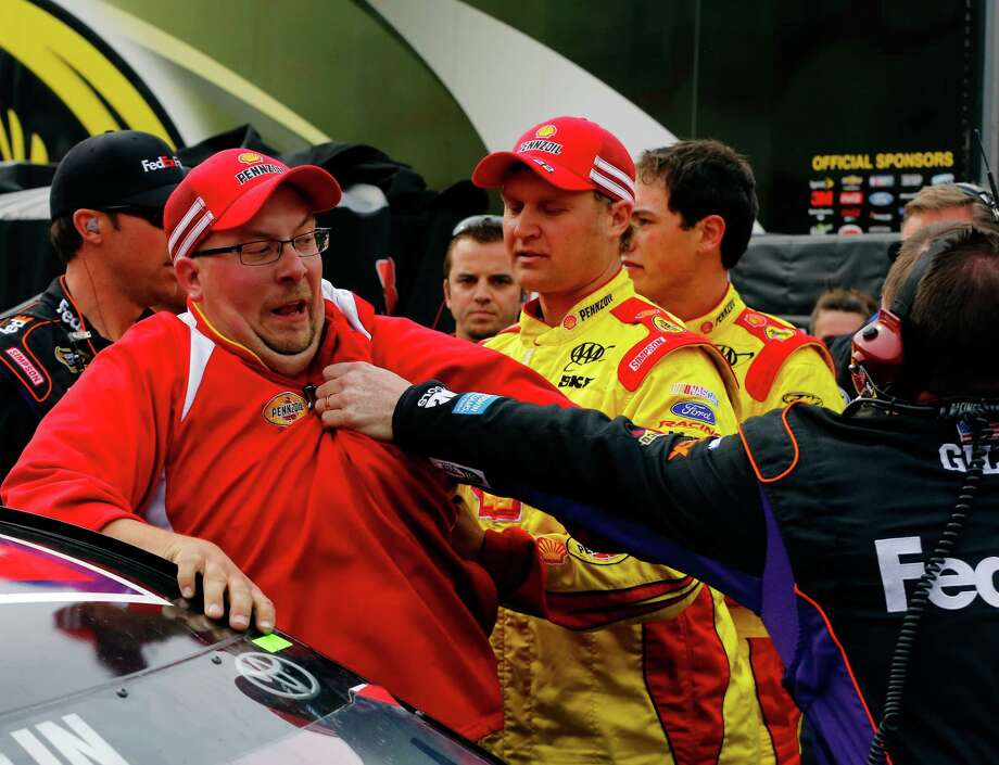 Dust-ups like this 2013 kerfuffle between crew members for Joey Logano and Denny Hamlin are few and far between at NASCAR tracks these days. Photo: Jared Wickerham, Staff / 2013 Getty Images